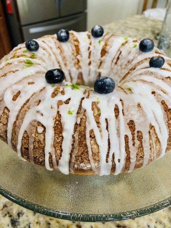 Reader Gioconda M's finished lemon bundt cake picture on a glass plate