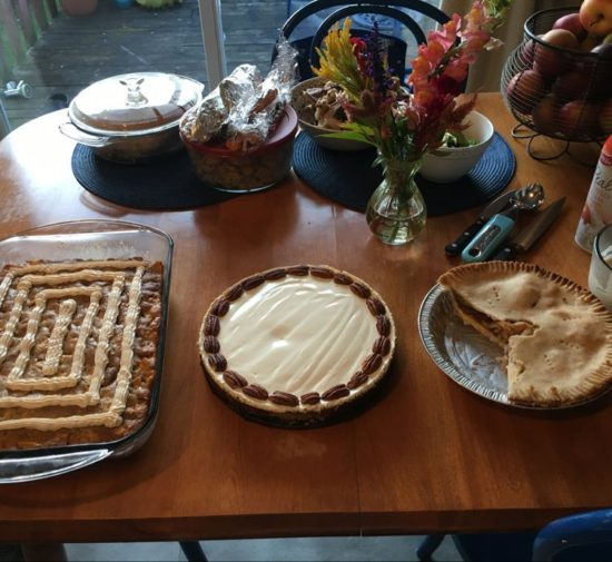 Reader Victoria T's photo of her finished cheesecake on a dessert table next to pie