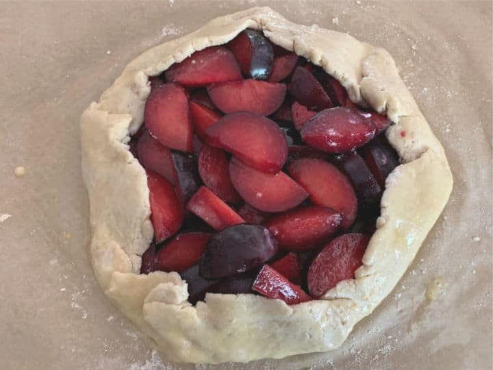 The galette with the pie crust folded over some of the fruit and ready to bake.