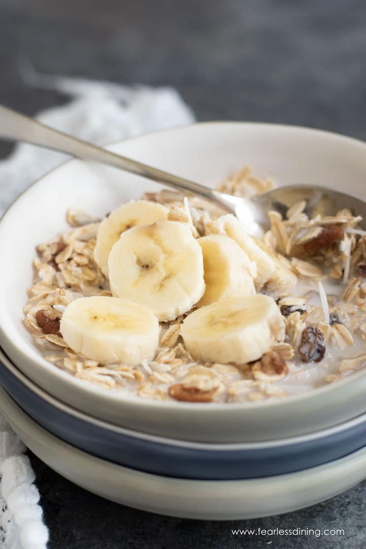 a bowl full of muesli with a spoon in the bowl