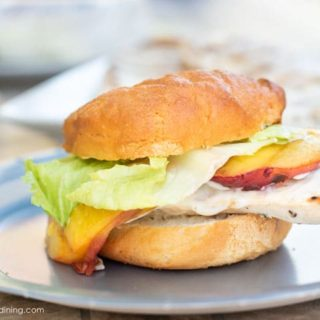 a grilled chicken breast burger on a paper plate