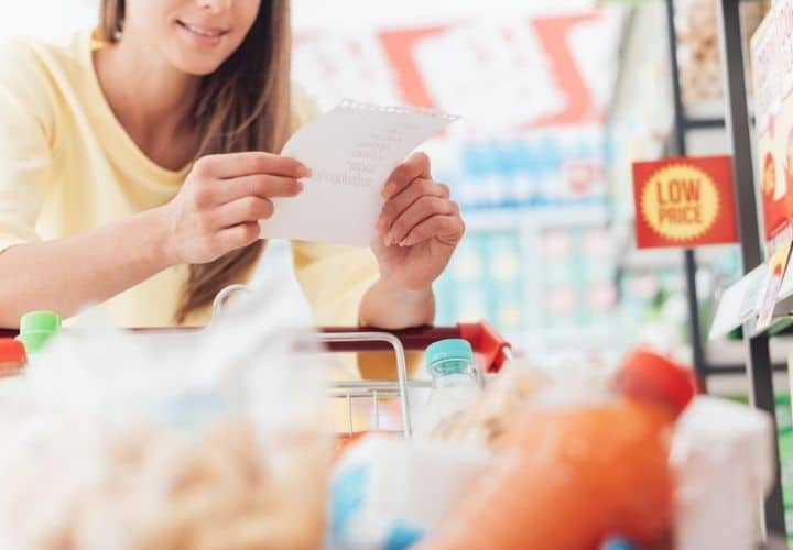 a grocery shopper holding a shopping list