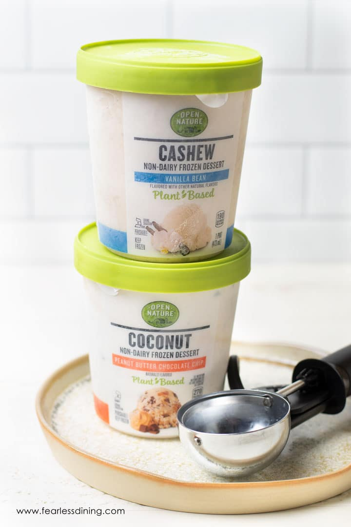 Open Nature brand non-dairy ice cream containers stacked on top of each other