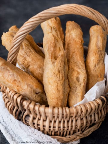 a basket of gluten free breadsticks