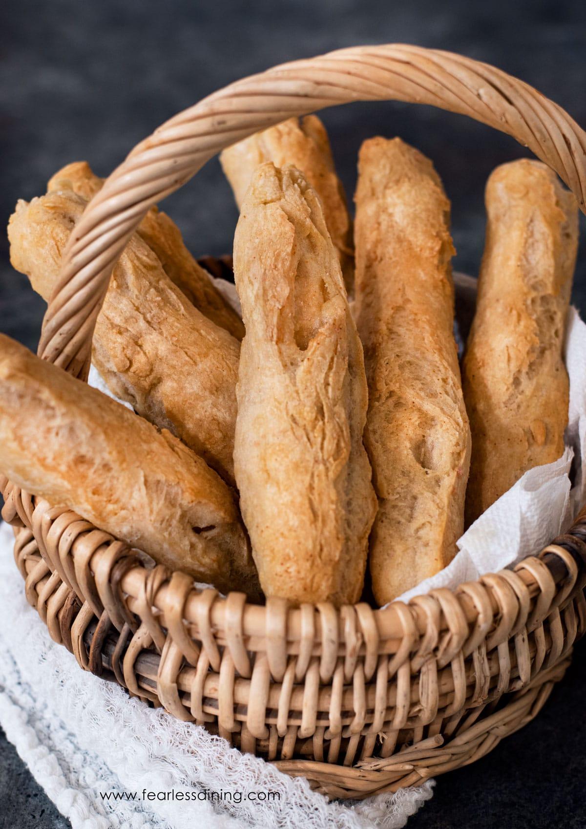 a basket of gluten free breadsticks