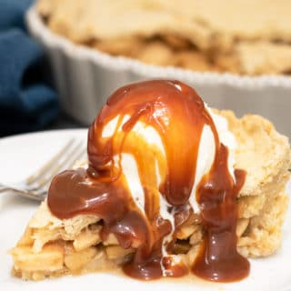 a slice of green chile apple pie with a scoop of vanilla ice cream and caramel sauce