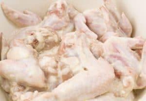 raw chicken marinading in buttermilk