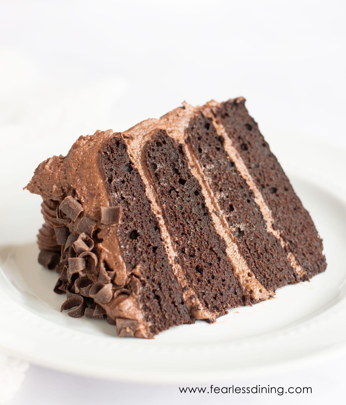 gluten free chocolate cake slice on a white plate