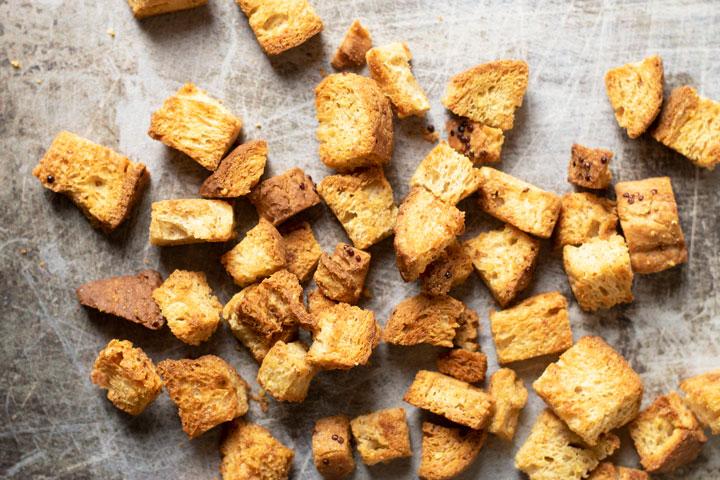 gluten free croutons on a metallic cookie sheet