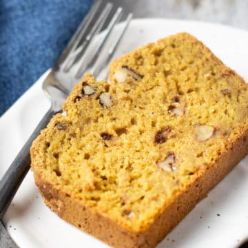 a close up of a slice of pumpkin bread on a plate