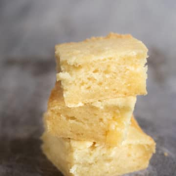 a stack of 3 butter mochi on a cookie sheet