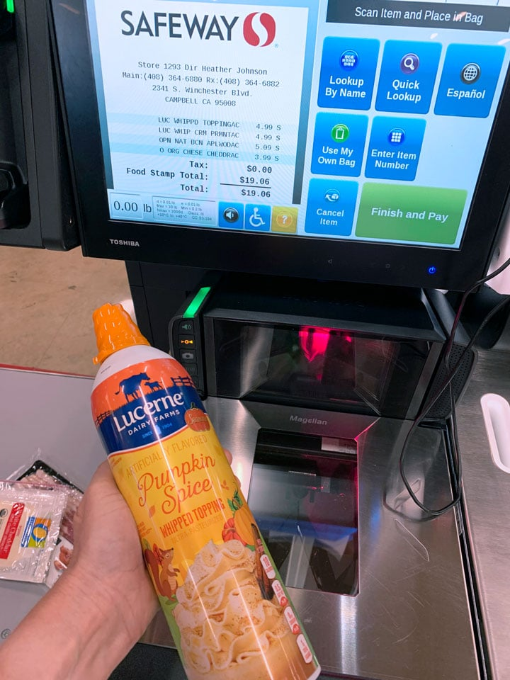 scanning Lucern whipped cream at the check out stand