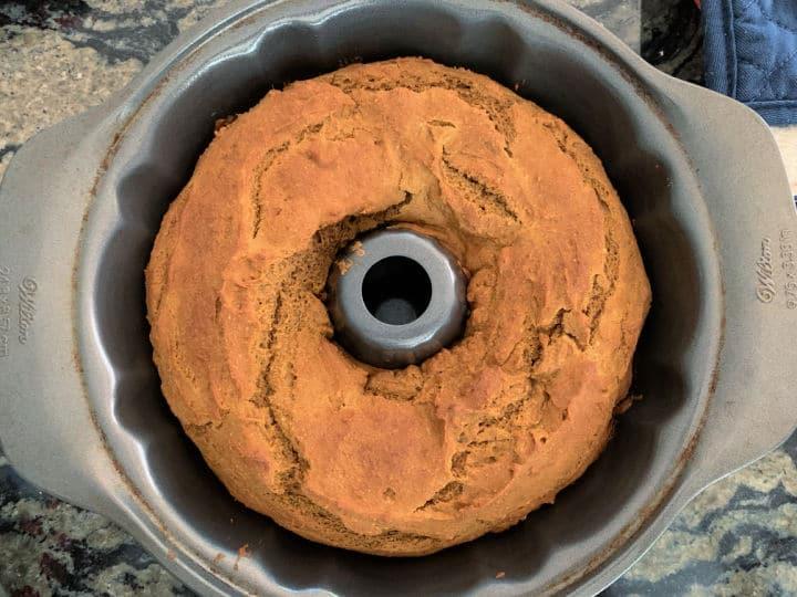 a baked pumpkin bundt cake in the pan