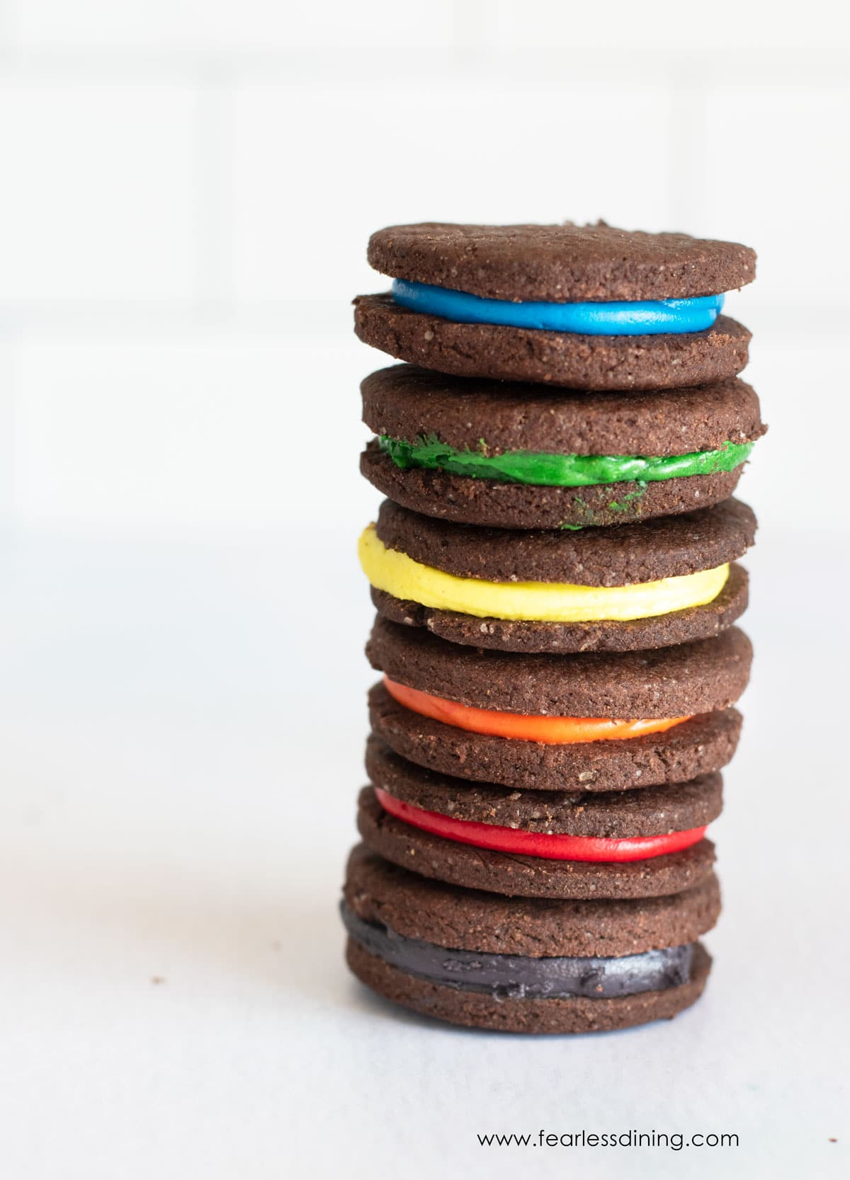 a tall stack of gluten free rainbow oreo cookies
