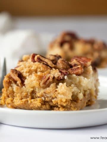 a slice of gluten free pumpkin dump cake on a plate