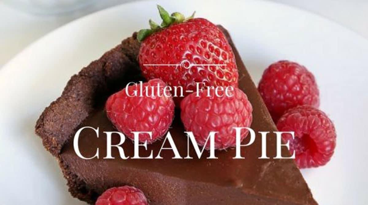a slice of chocolate cream pie with raspberries