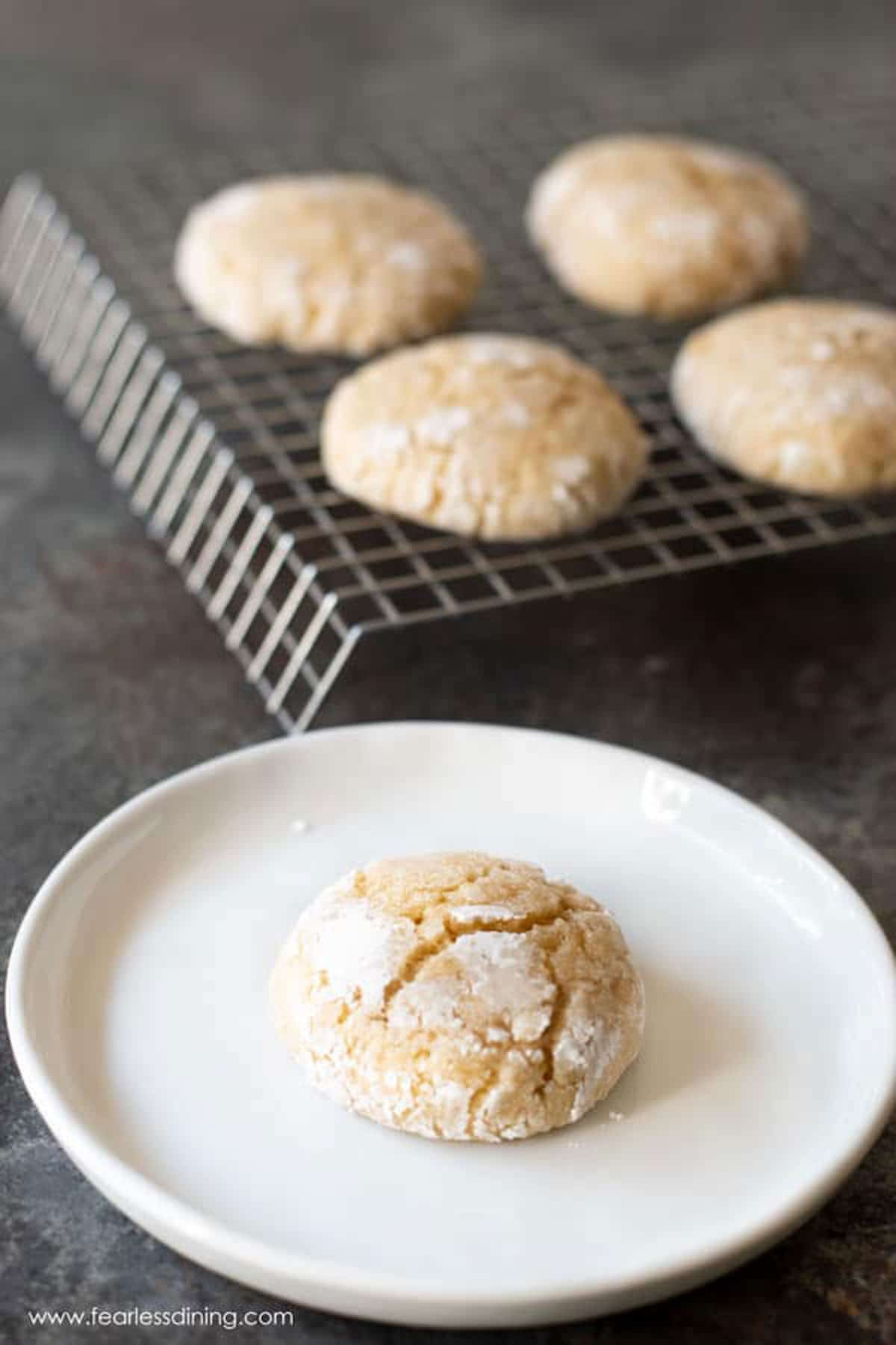 an eggnog crinkle cookie on a white plate