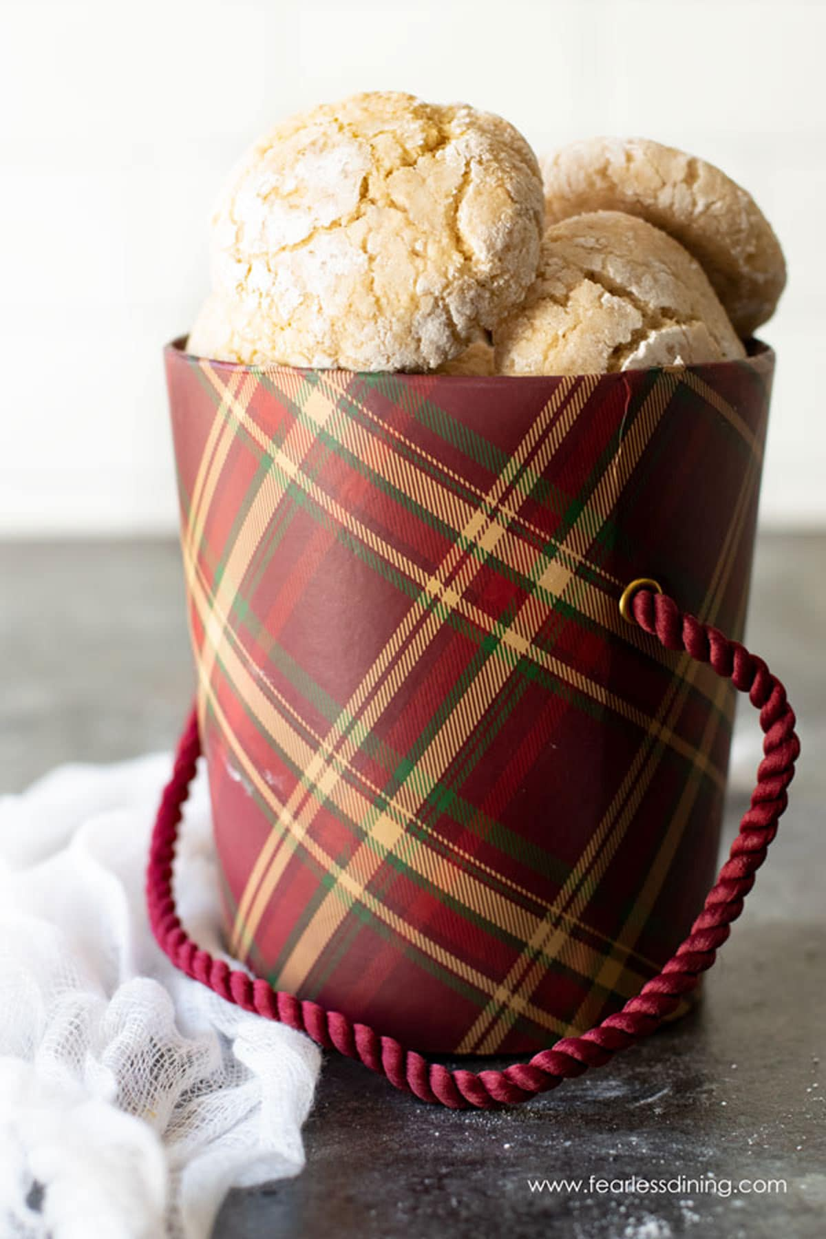 a maroon gift box filled with eggnog cookies