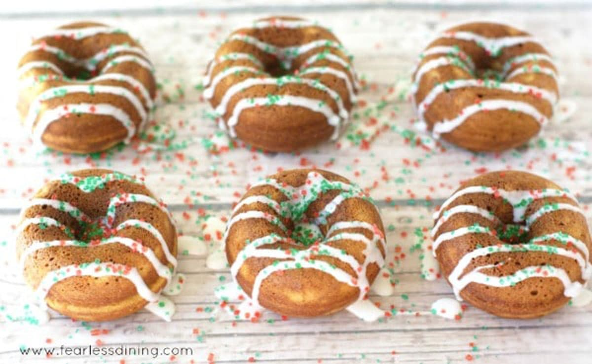 Two rows of gingerbread donuts on a rack