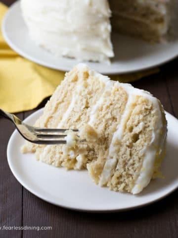 a fork slicing into a piece of lemon cake