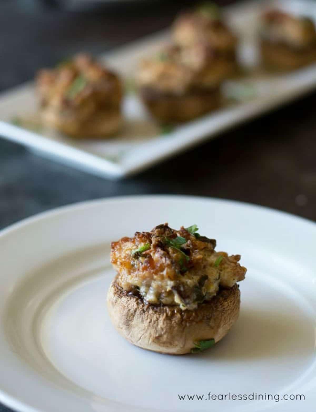 a stuffed mushroom on a plate.