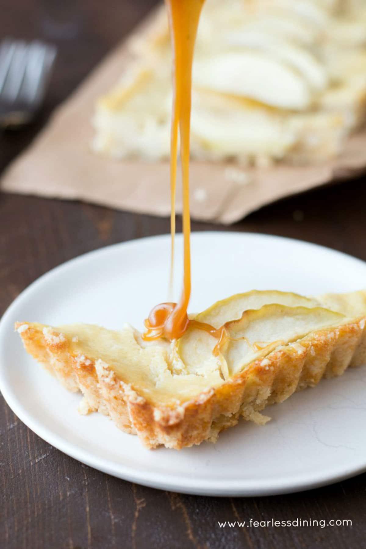 a slice of caramel apple tart on a plate
