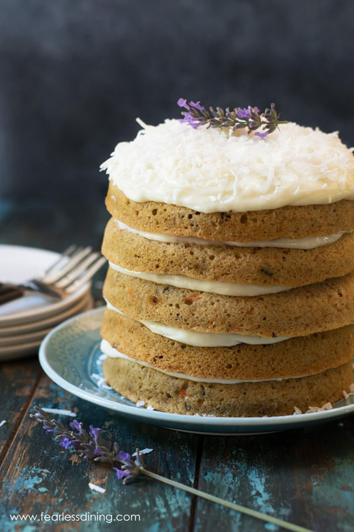a fancy carrot layer cake with cream cheese frosting