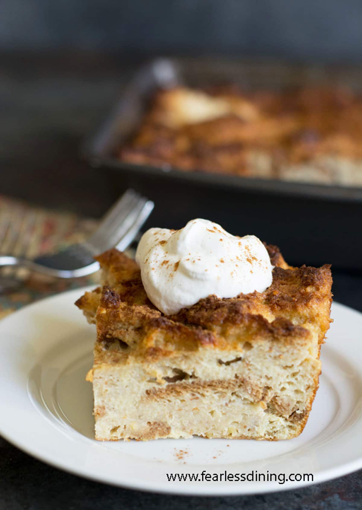 a slice of eggnog bread pudding on a plate
