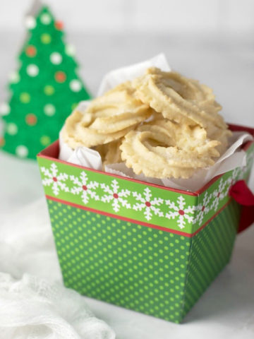a green gift box filled with butter cookies