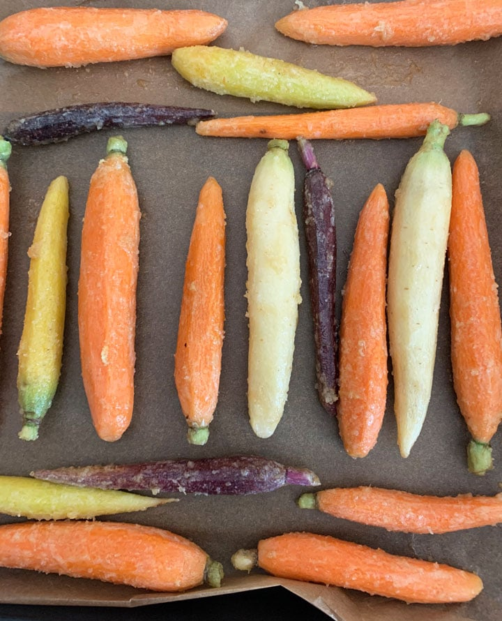 carrots on a baking sheet ready to bake