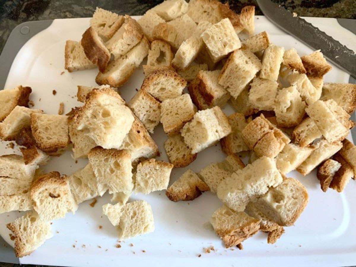 cut bread cubes on a cutting board