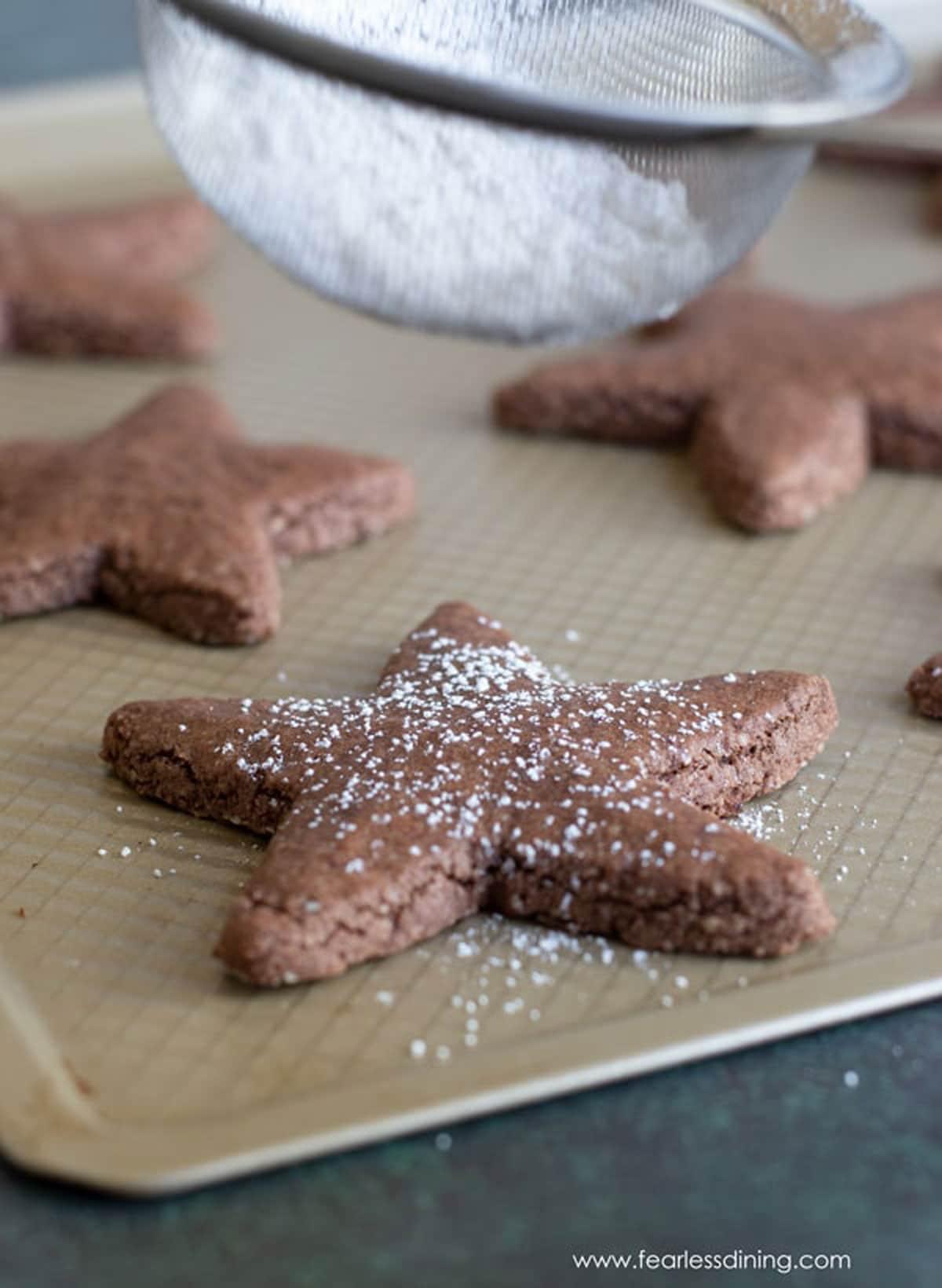 dusting cookies with powdered sugar