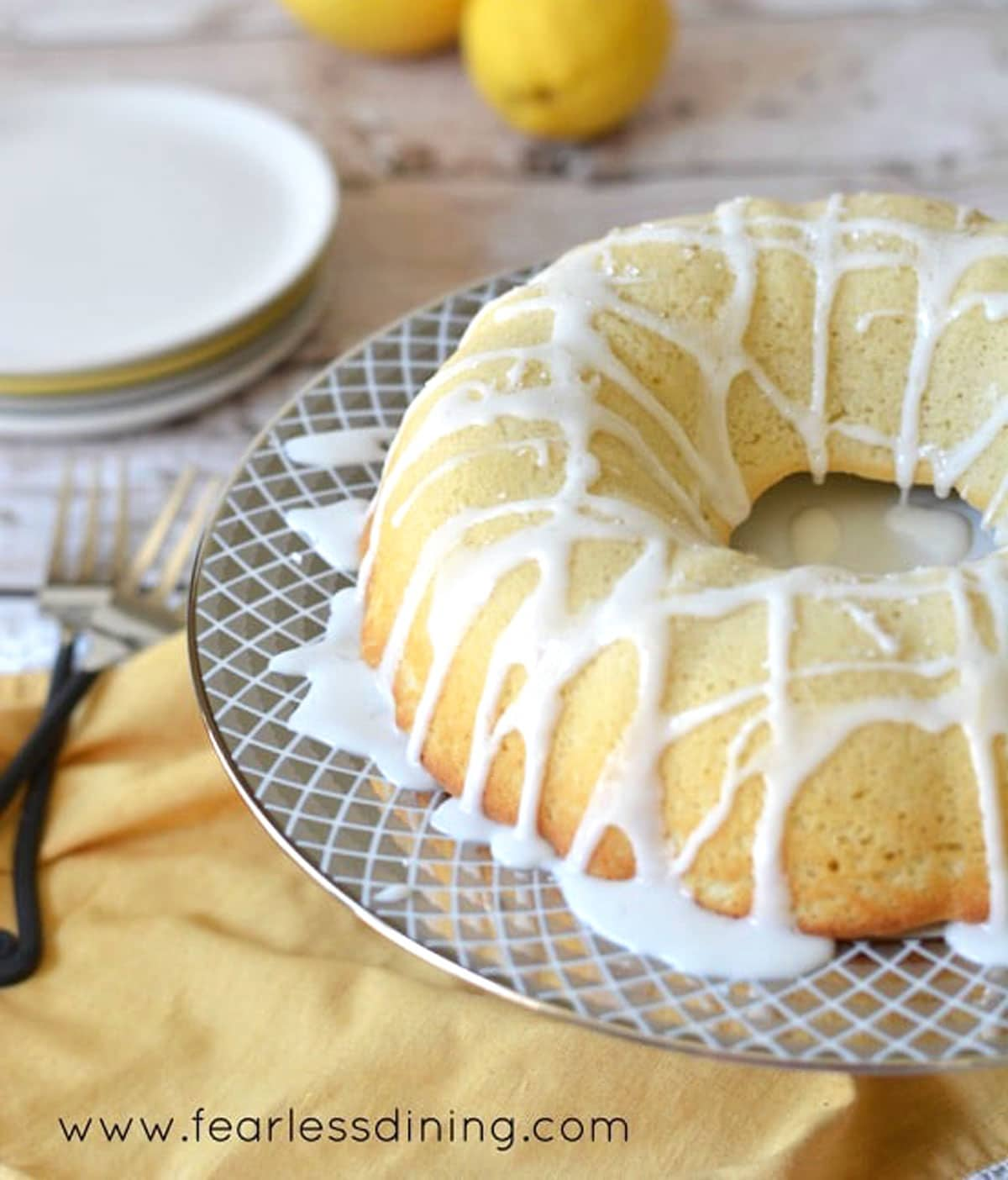 a lemon bundt cake on a cake stand