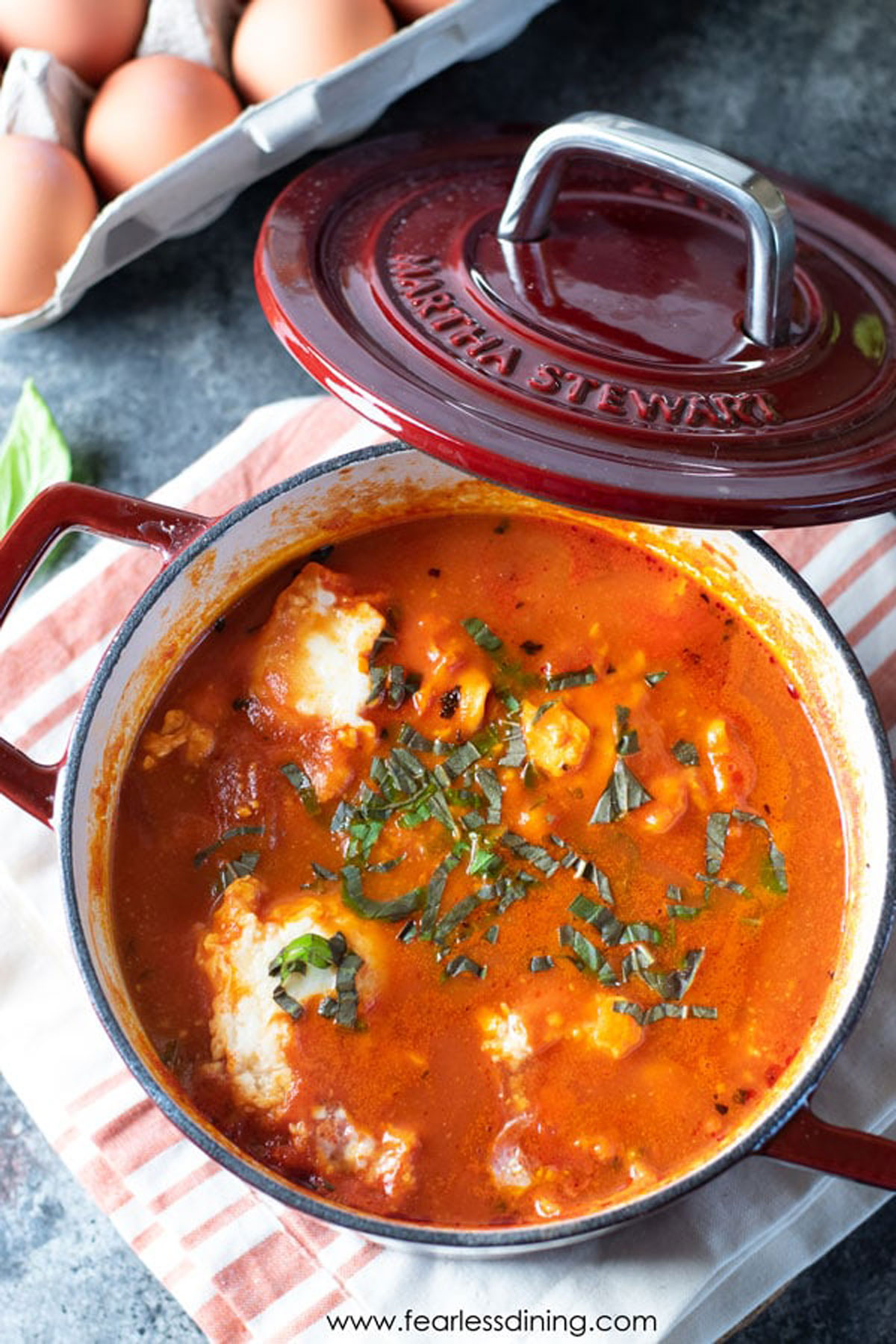 a small Dutch oven filled with shakshuka