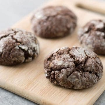 chochocolate crinkle cookies on a cutting board