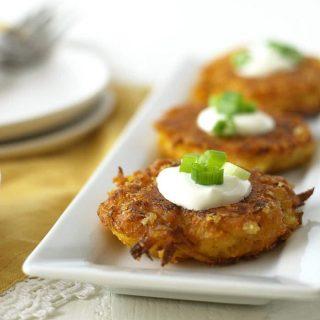 delicata fritters on a white rectangular serving platter