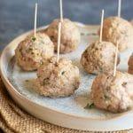 a serving dish full of chicken meatballs