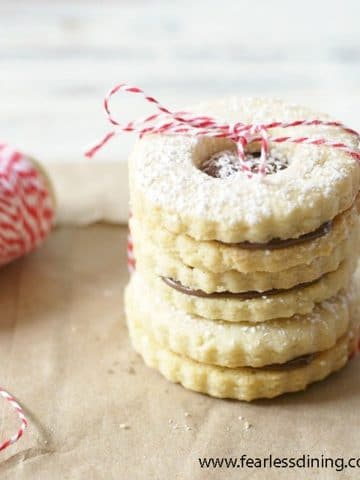 a stack of gluten free linzer cookies