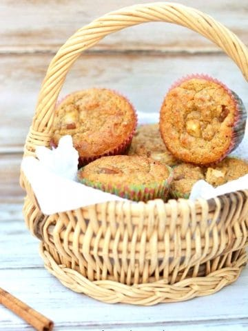 a basket full of pear muffins