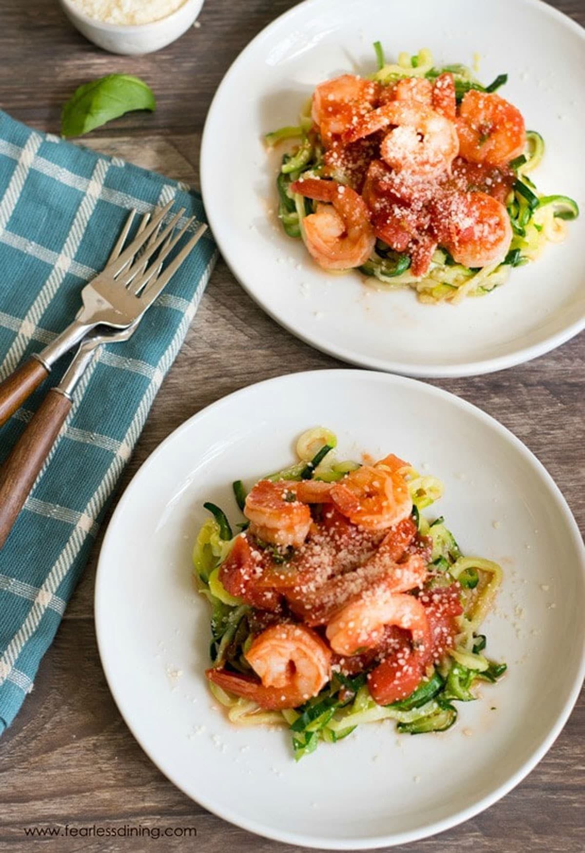 a top view of two plates of shrimp fra diavolo