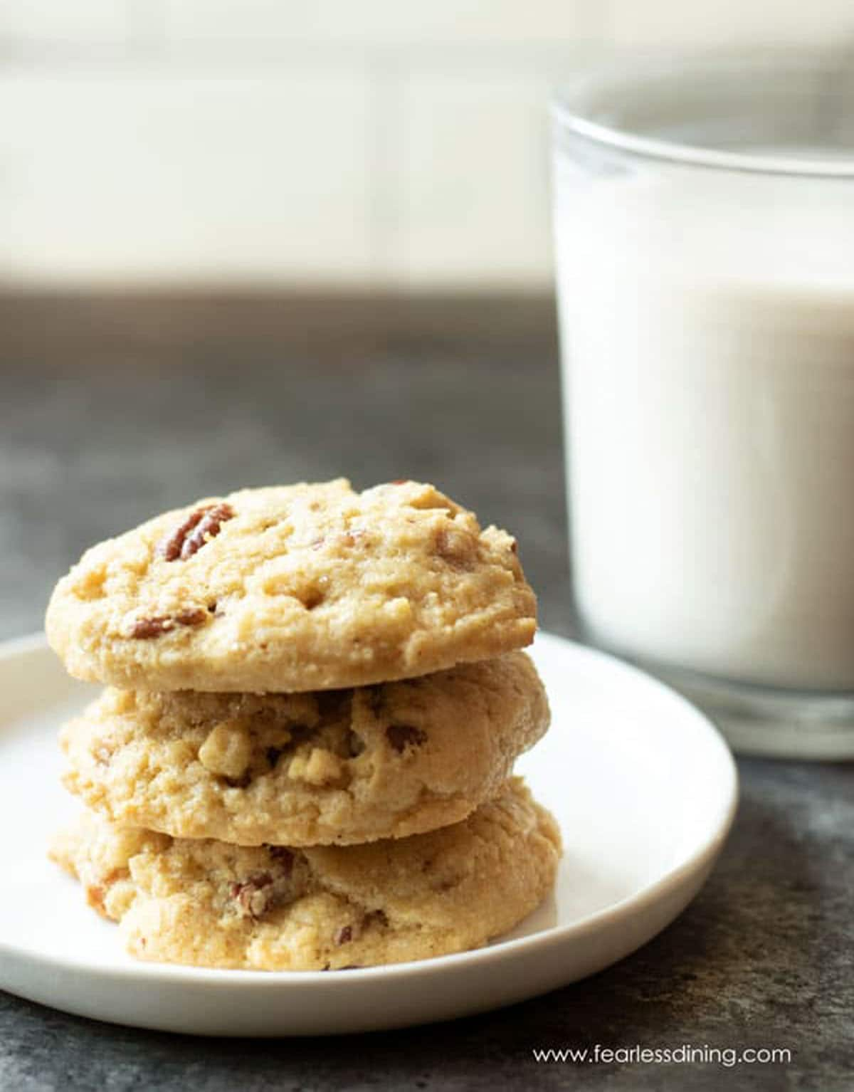 a stack of three cookies on a plate
