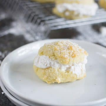a filled cream puff on a white plate