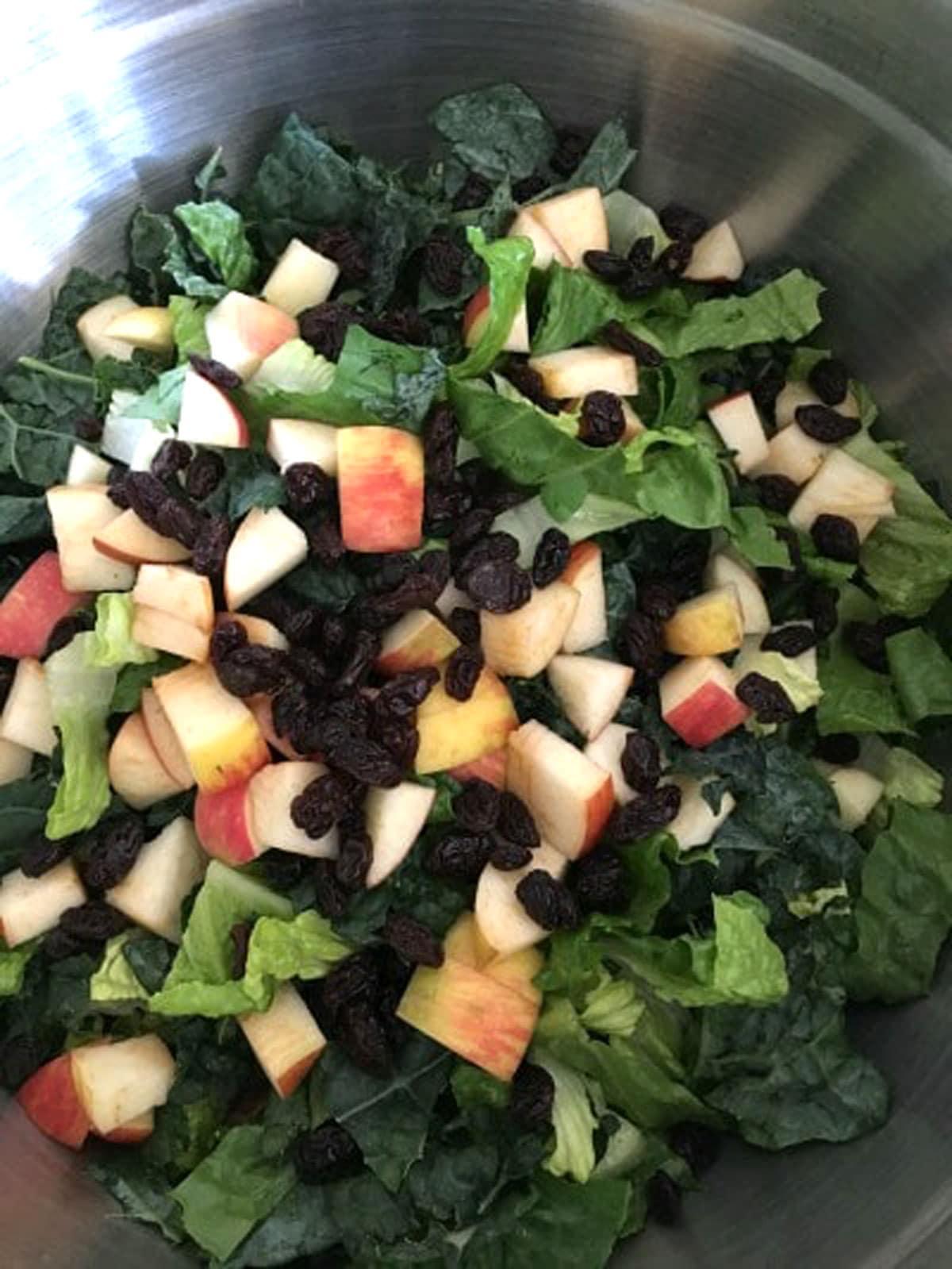 kale salad ingredients in a bowl