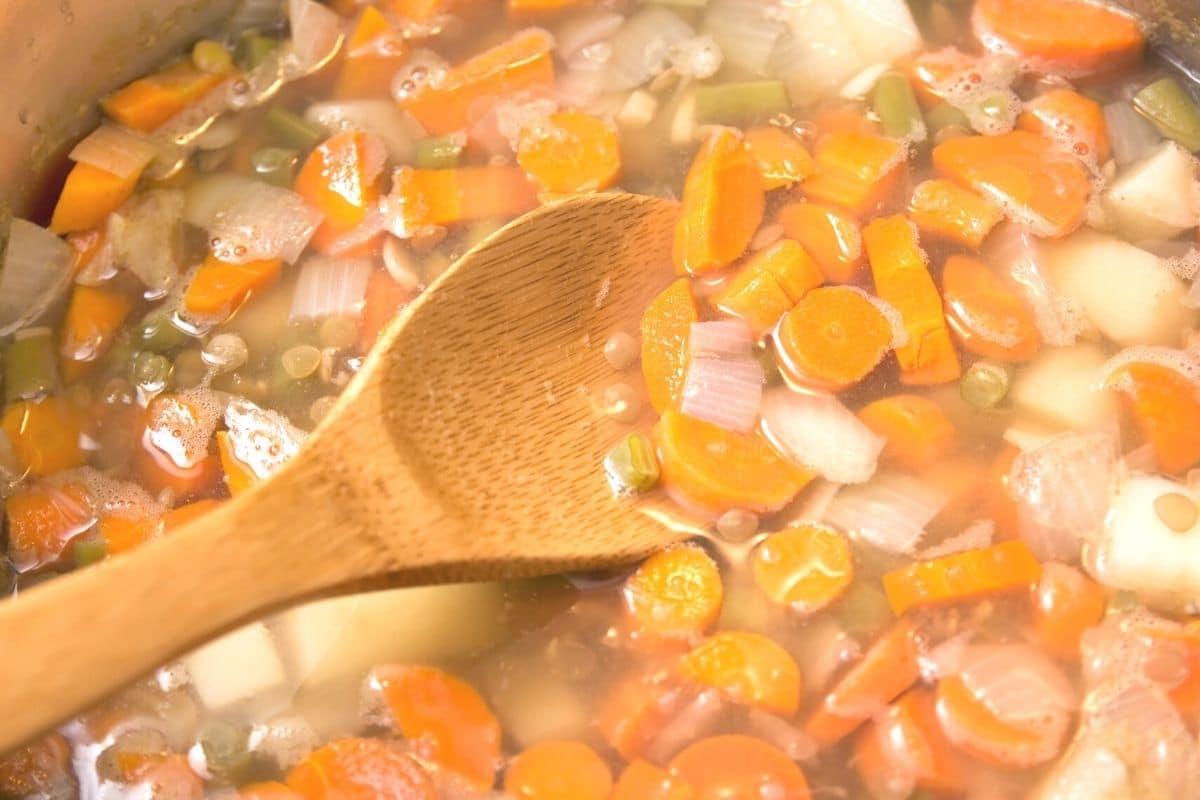 lentil soup cooking in a large pot