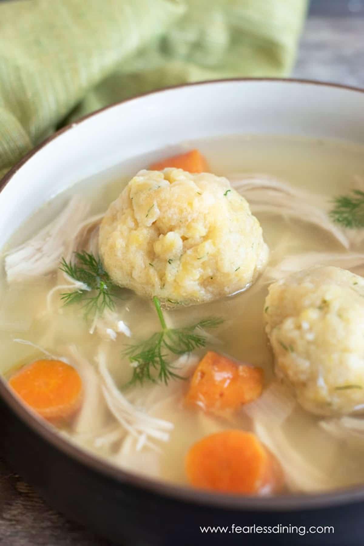 close up of a bowl of matzo ball soup