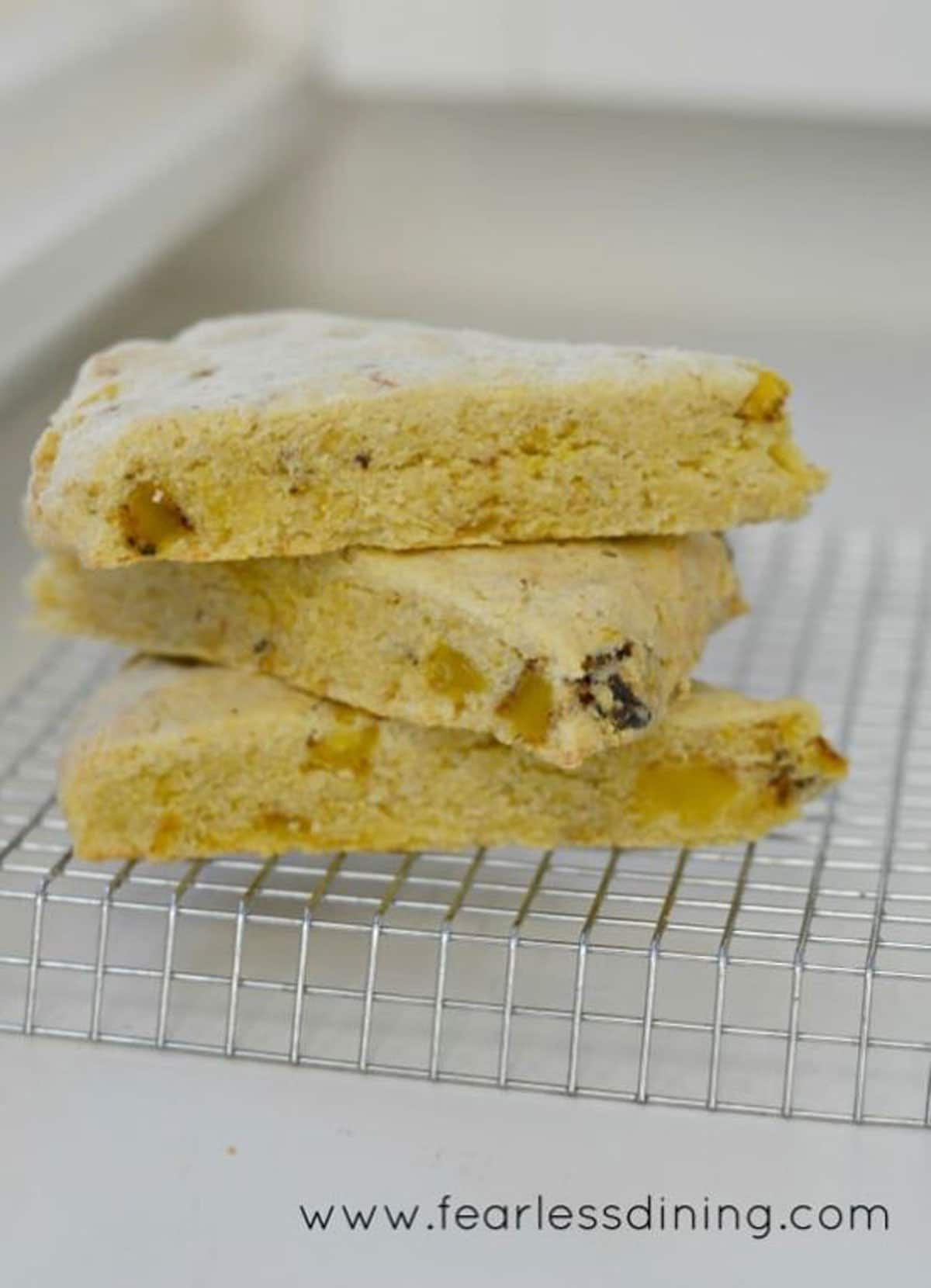 cornmeal scones stacked on the counter.