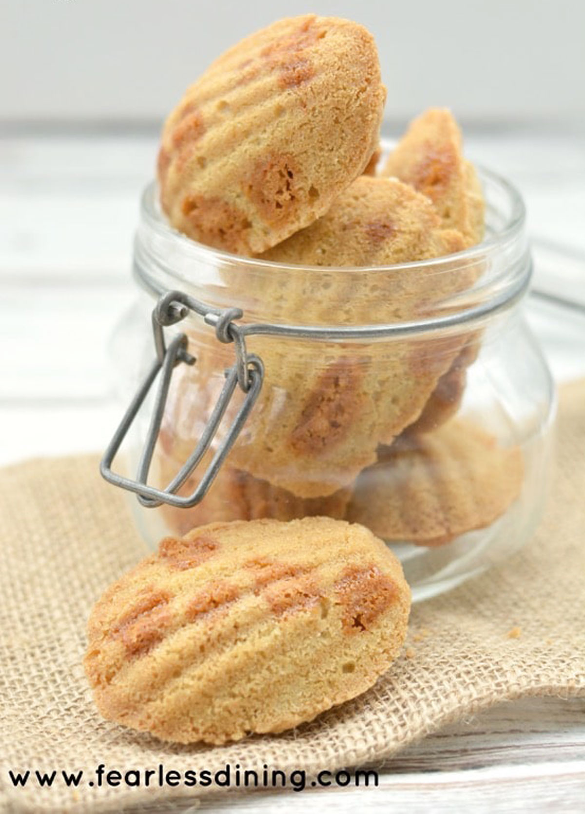 a large glass jar filled with butterscotch madeleines