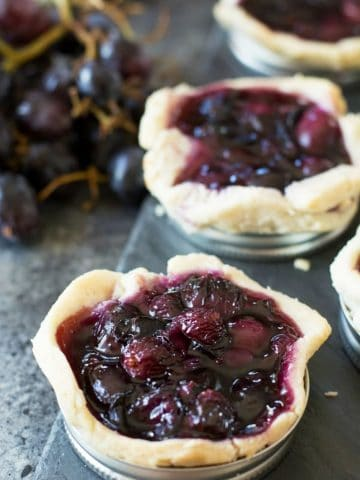 grape galettes on a slate serving dish