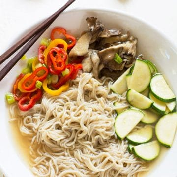 a bowl of ramen soup with vegetables