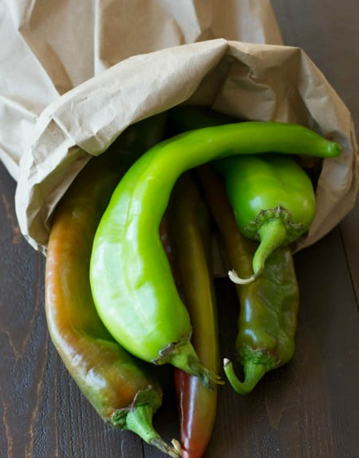 a paper bag full of hatch chiles